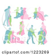 Clipart Of Blue Green And Pink Silhouetted Families Royalty Free Vector Illustration by AtStockIllustration