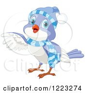 Clipart Of A Cute Winter Bird Pointing With A Wing Royalty Free Vector Illustration