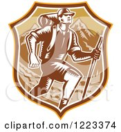 Clipart Of A Retro Woodcut Man Hiking Over Mountains In A Brown Shield Royalty Free Vector Illustration by patrimonio