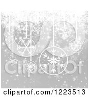 Christmas Background Of Snowflake Baubles Over Gray