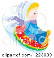 Clipart Of A Winter Boy Tubing In The Snow 2 Royalty Free Vector Illustration