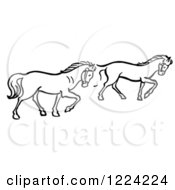Clipart Of Black And White Two Trotting Horses Royalty Free Vector Illustration
