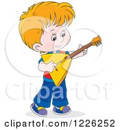 Caucasian Boy Playing A Balalaika Guitar