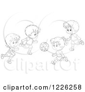 Clipart Of Outlined Boys And Girls Playing Soccer Royalty Free Vector Illustration