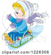 Caucasian Boy On A Snow Sled