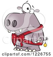 Clipart Of A Cartoon Christmas Hippo In A Bow And A Bauble Royalty Free Vector Illustration