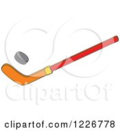 Clipart Of A Hockey Stick And Puck Royalty Free Vector Illustration