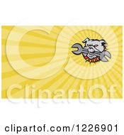 Clipart Of A Bulldog Biting A Wrench And Yellow Rays Background Or Business Card Design Royalty Free Illustration by patrimonio