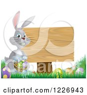 Gray Bunny Rabbit With A Basket Of Easter Eggs By A Wood Sign