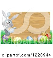 Gray Bunny Rabbit And Easter Eggs By A Wood Sign