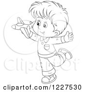 Clipart Of An Outlined Boy Playing With A Toy Plane Royalty Free Vector Illustration
