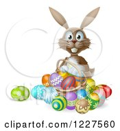 Clipart Of A Brown Bunny With Easter Eggs And A Basket Royalty Free Vector Illustration by AtStockIllustration