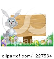 Clipart Of A Gray Bunny By A Wood Sign And Easter Eggs Royalty Free Vector Illustration by AtStockIllustration