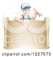Clipart Of A Happy Brunette Worker Man Holding A Wrench And Pointing Down At A Scroll Sign Royalty Free Vector Illustration
