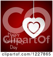 Happy Valentines Day Greeting With A Heart Pendant Over Red