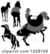 Clipart Of A Silhouetted Cowboy And Horses Royalty Free Vector Illustration