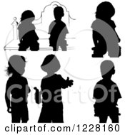 Clipart Of Silhouetted Children Royalty Free Vector Illustration by dero