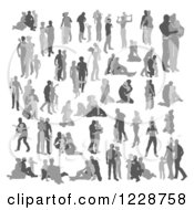 Clipart Of Silhouetted Grayscale Families Royalty Free Vector Illustration by AtStockIllustration