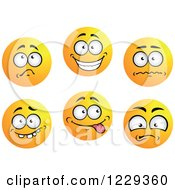 Clipart Of Yellow Emoticon Smiley Faces Royalty Free Vector Illustration by Vector Tradition SM