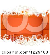 Clipart Of An Orange Frame With Flowers Shamrocks And Butterflies Royalty Free Vector Illustration by merlinul