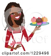 Clipart Of A Happy Black Baker Woman Holding A Tray Of Cupcakes Royalty Free Vector Illustration by peachidesigns #COLLC1229496-0137