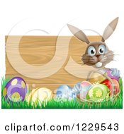 Brown Bunny By A Wood Sign With Grass And Easter Eggs