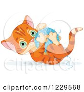 Cute Tabby Ginger Kitten Playing With A Ball Of Yarn