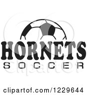 Clipart Of A Black And White Ball And HORNETS SOCCER Team Text Royalty Free Vector Illustration by Johnny Sajem