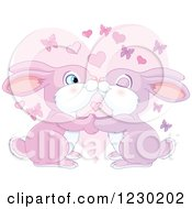 Clipart Of A Cute Bunny Rabbit Couple Kissing Over A Heart With Butterflies Royalty Free Vector Illustration