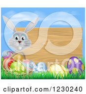 Gray Rabbit With A Basket And Easter Eggs By A Wooden Sign Under A Blue Sky