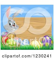 Gray Bunny Rabbit With A Basket And Easter Eggs By A Wooden Sign Under A Blue Sky