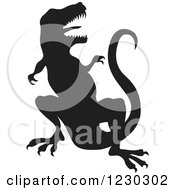 Clipart Of A Black Silhouetted Vicious T Rex Royalty Free Vector Illustration