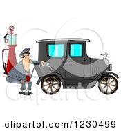 Male Attendant Pumping An Antique Car With An Old Fashioned Gas Pump