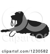 Clipart Of A Black Silhouetted Dog Resting With A Leash In His Mouth Royalty Free Vector Illustration