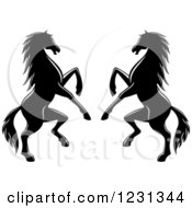 Clipart Of Two Black And White Rearing Horses 3 Royalty Free Vector Illustration