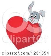 Clipart Of A Valentine Bunny Rabbit Behind A Heart Royalty Free Vector Illustration