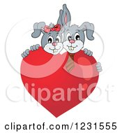 Clipart Of A Valentine Bunny Rabbit Couple Behind A Heart Royalty Free Vector Illustration