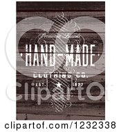 Clipart Of A Distressed Hand Made Clothing Label Over Wood Royalty Free Vector Illustration