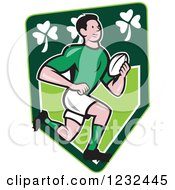 Clipart Of A Cartoon Rugby Player Running Over An Irish Shamrock Shield Royalty Free Vector Illustration
