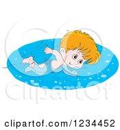 Caucasian Boy Swimming Laps In A Pool