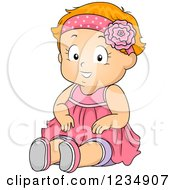 Happy Red Haired Toddler Girl Sitting In A Pink Dress