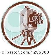 Clipart Of A Retro Movie Camera Over A Pastel Blue And Brown Circle Royalty Free Vector Illustration
