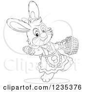 Clipart Of A Black And White Female Easter Bunny With A Basket Of Eggs Royalty Free Vector Illustration