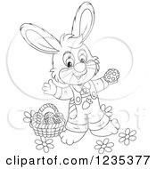 Clipart Of A Black And White Male Easter Bunny Standing By A Basket Of Eggs Royalty Free Vector Illustration