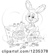 Clipart Of A Black And White Male Bunny Painting A Picture Of An Easter Egg Royalty Free Vector Illustration