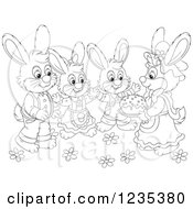 Clipart Of A Black And White Group Of Dressed Rabbits With An Easter Cake Royalty Free Vector Illustration