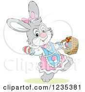 Clipart Of A Gray Female Easter Bunny Carrying A Basket Of Eggs Royalty Free Vector Illustration