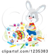 Clipart Of A Gray Male Bunny Painting A Picture Of An Easter Egg Royalty Free Vector Illustration