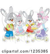 Clipart Of A Family Of Dressed Rabbits With An Easter Cake Royalty Free Vector Illustration
