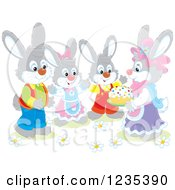 Clipart Of A Group Of Dressed Rabbits With An Easter Cake Royalty Free Vector Illustration